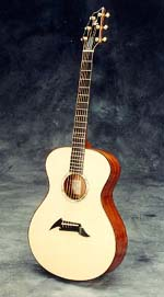 camille's breedlove looks like this, but is constructed of striped ebony.